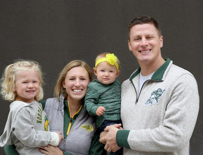 Dr. Vetter, your Fargo dentist with his wife and two daughters all wearing Bison gear.