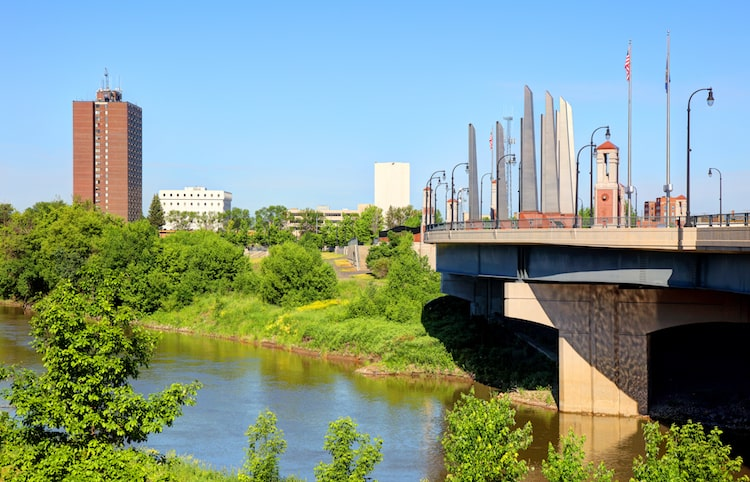 The green areas, river, and bridge found in Fargo, ND