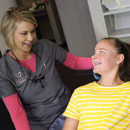 caring staff member with girl